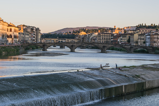 Old dam across the Arno river in Florence, Italy
