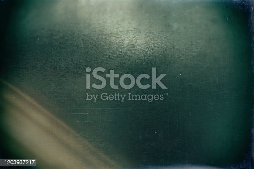 1126727680 istock photo Old damaged filmstrip texture background 1203937217