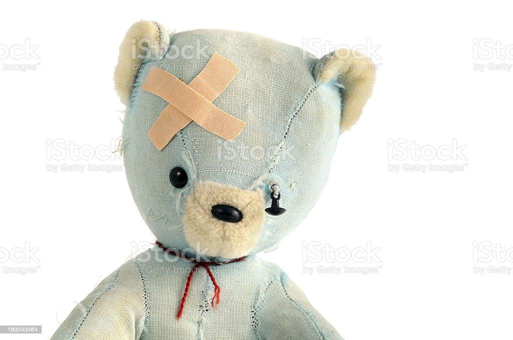 old damaged teddy bear with adhesive bandage royalty-free stock photo