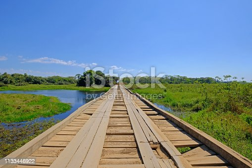 istock Old damaged wooden bridge on the transpantaneira dirt road with Pantanal wetland, Porto Jofre, Mato Grosso, Brazil 1133446922