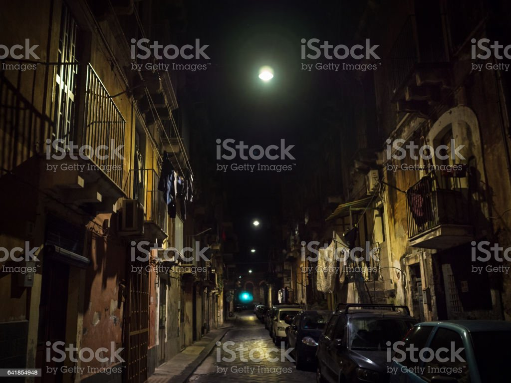 Old dark alley in Catania, Sicily, by night stock photo