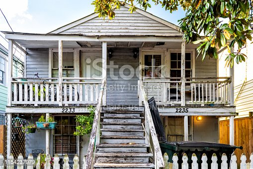 New Orleans, USA - April 22, 2018: Old Dauphine street district in Louisiana famous town with antique house