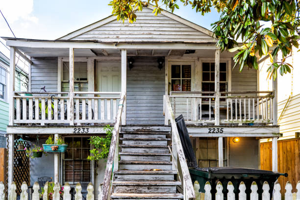 Old Dauphine street district in Louisiana famous town with antique house New Orleans, USA - April 22, 2018: Old Dauphine street district in Louisiana famous town with antique house run down stock pictures, royalty-free photos & images
