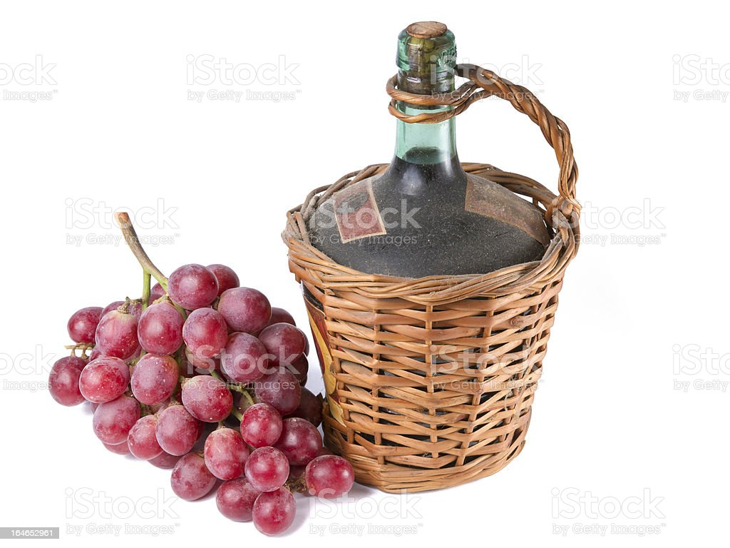 Old Decanter of Red Wine with Grapes. royalty-free stock photo