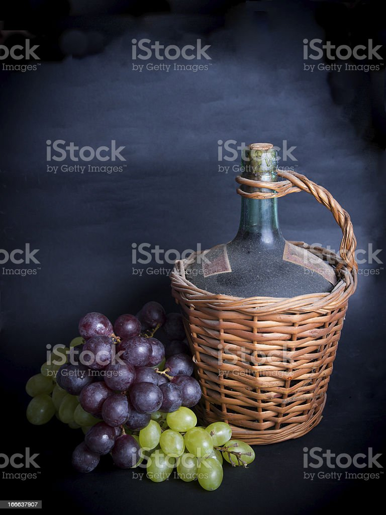 Old Decanter of Red Wine with Grapes royalty-free stock photo