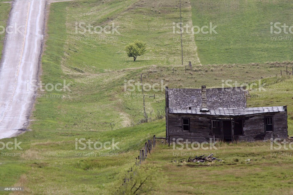 Old delapidated house near country road stock photo