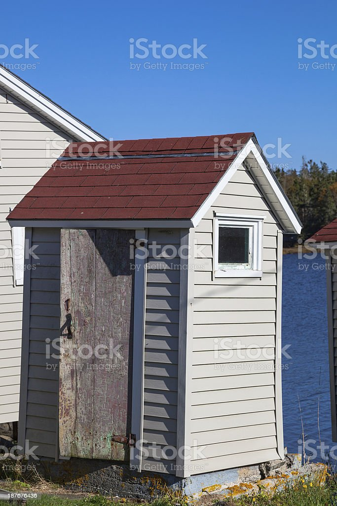 old delapidated wooden outhouse toilet stock photo