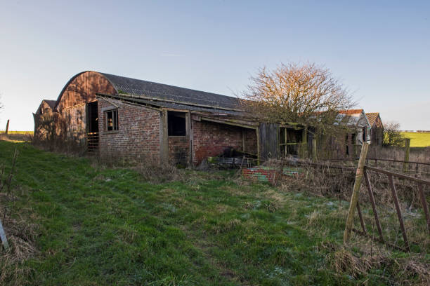 Old derelict farm building barn in remote rural setting stock photo