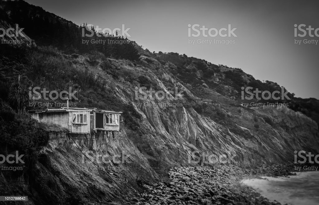 Old derelict house on the edge off the cliff royalty-free stock photo