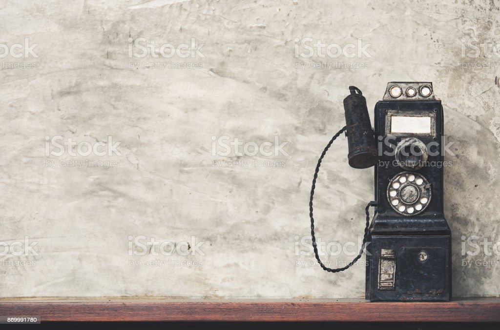 Old design of black telephone, vintage tone with copy space stock photo