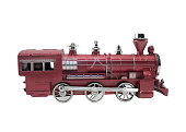 Isolated red and metal colors train toy profile view.