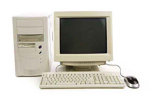 Old desktop computer with mouse stock photo