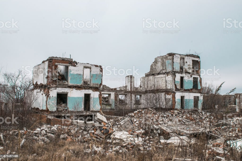 Old destroyed an abandoned multi-storey building in a military town stock photo