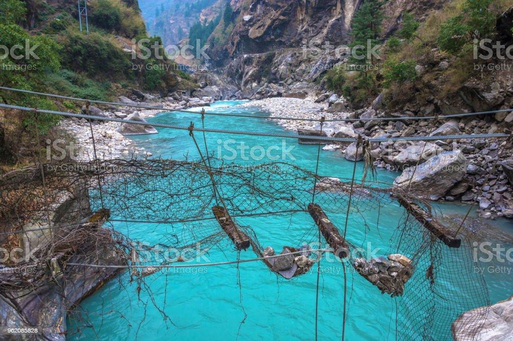 Old destroyed suspension bridge. стоковое фото