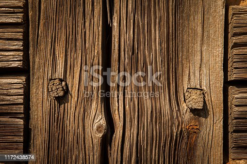 666644136 istock photo Old destroyed wood and out of focus wood in the background 1172438574
