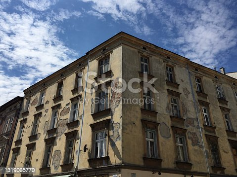 istock Old deteriorating buildings in Kraków, Poland, in the old Jewish quarter of Kazimierz. 1319065770