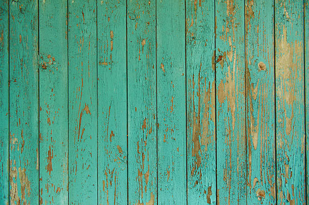 Old devastated wood wall with peeling paint stock photo