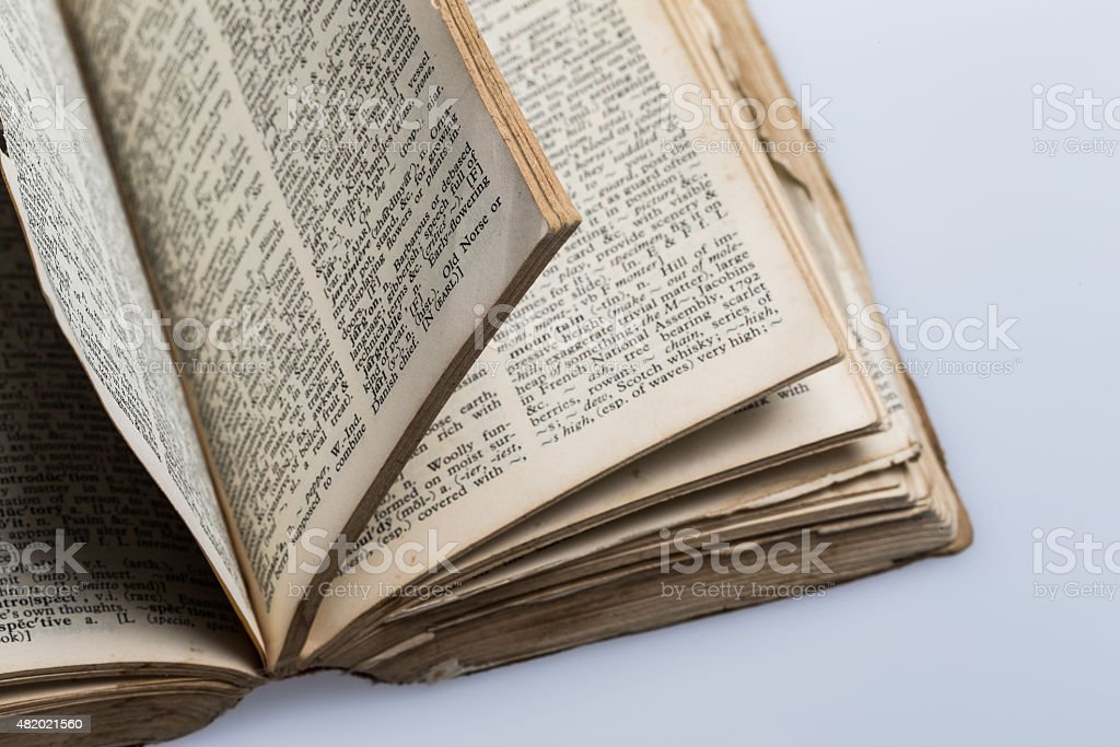 Old Dictionary on white background stock photo