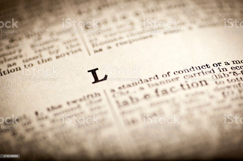 Old dictionary open at letter L stock photo