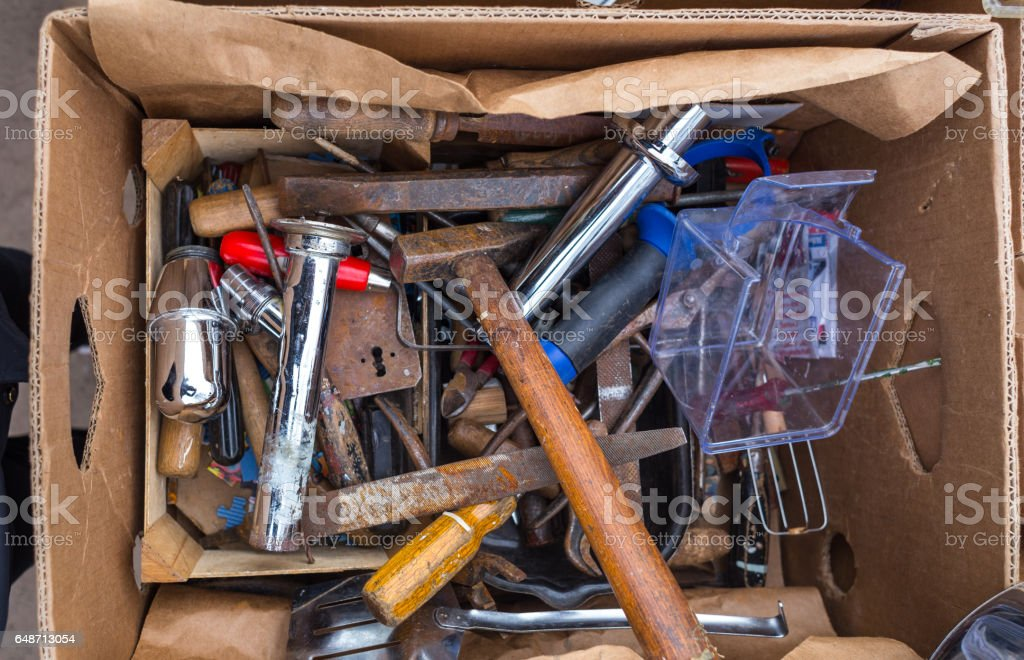 Old Different Rusted Stuff and Tools at Box stock photo