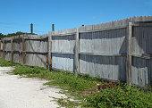 istock Old dilapidated stockade fence 502099930