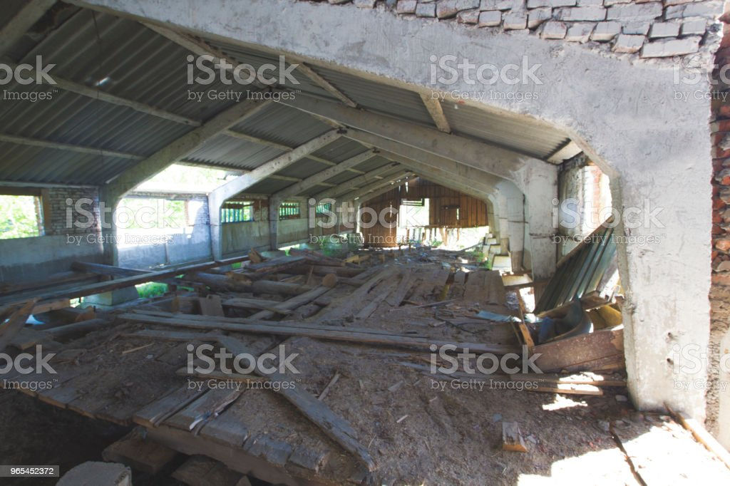 Old dilapidated village building and the wall of dilapidated logs royalty-free stock photo