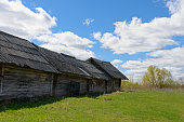 istock Old dilapidated wooden house on a bright sunny day 816290780