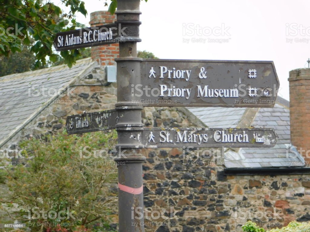 Old Directions sign on Lindisfarne (The Holy Island) stock photo