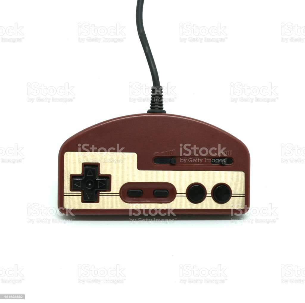 Old dirt video game controller isolated on white background. stock photo