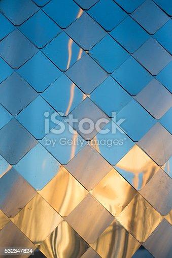 472923810 istock photo old, dirty aluminum metal wall facade panel with rhombus, similar 532347824