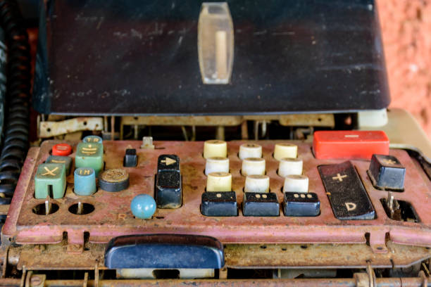 Old, dirty and damaged mechanical calculating machine stock photo