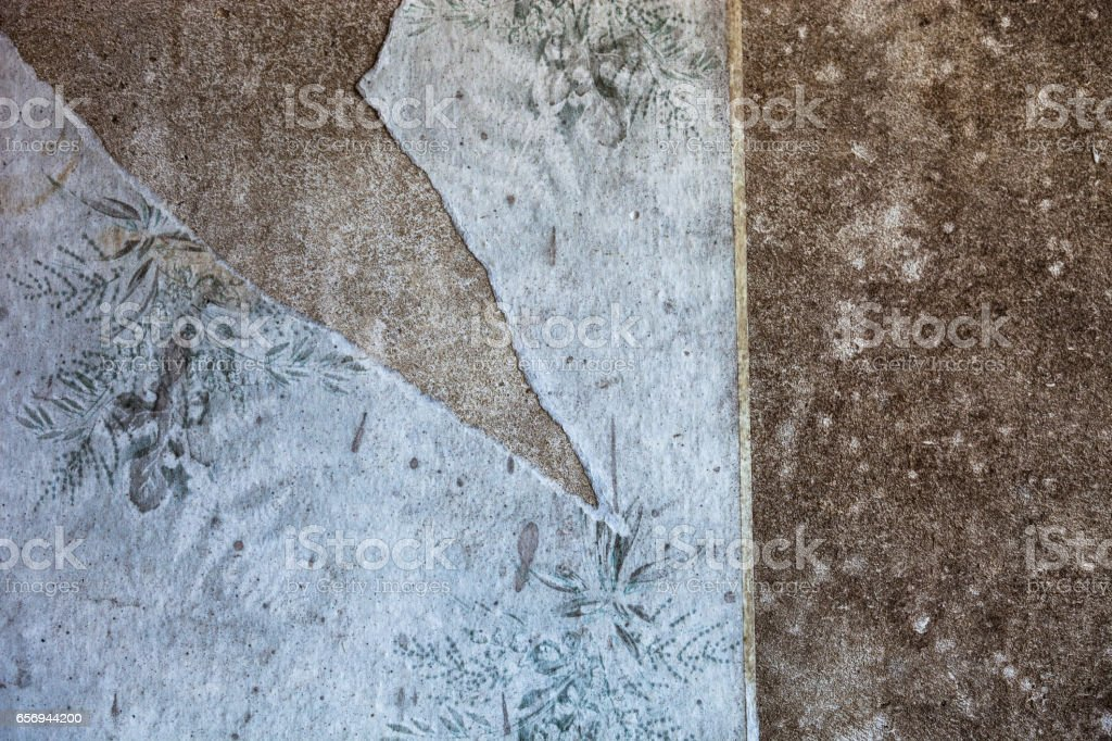 Old dirty and torn wallpaper - Stock image .