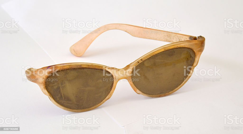 Old dirty  cat eye shaped sunglasses stock photo