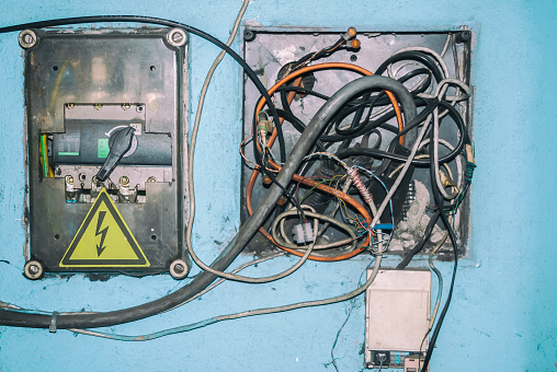 Old  dirty electric transformer box with wires