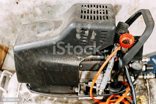 693910734 istock photo old dirty garage air compressor, engine 952689018