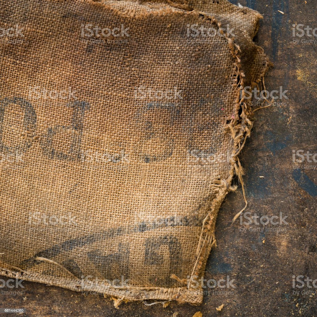 Old dirty hessian sack bag stamped used as upholstery material stock photo