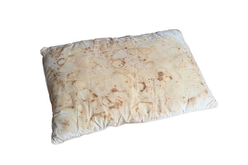Old dirty pillow with saliva stain and fungus cause of illness, isolated white background with clipping path