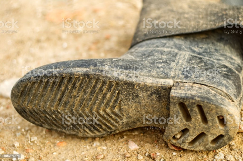 Old dirty rubber boot. stock photo