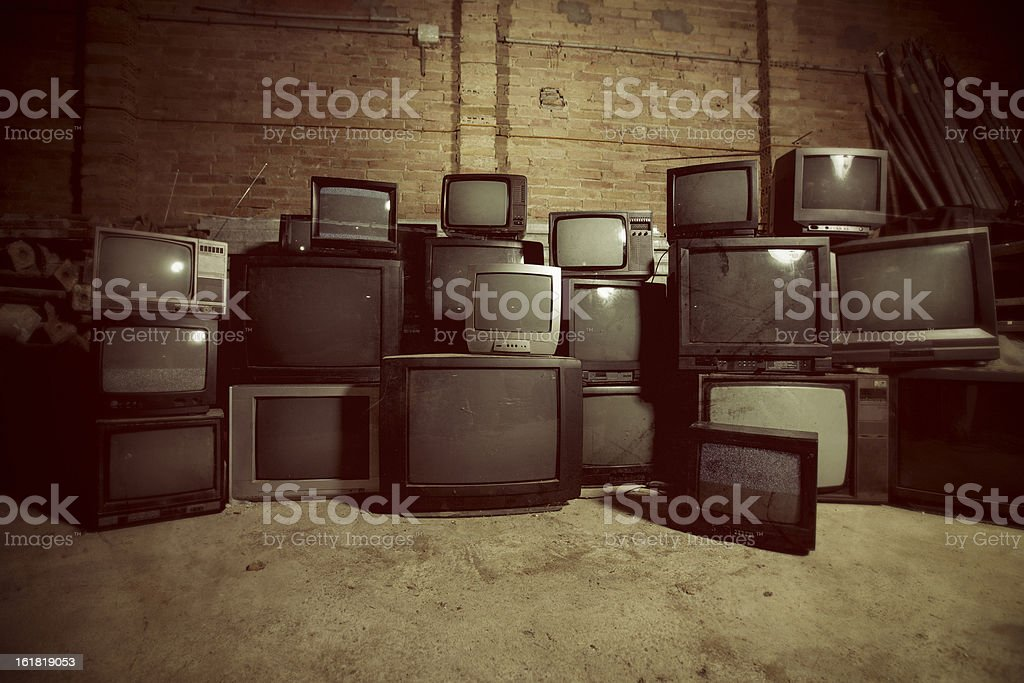 Old dirty televisions stock photo