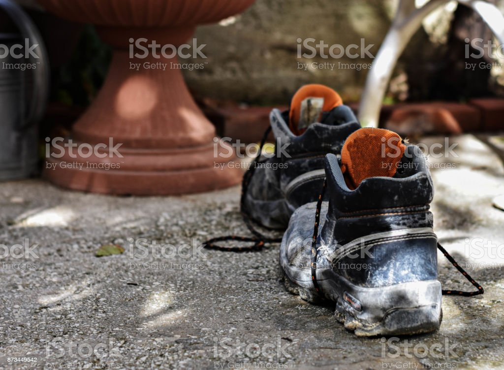 closeup of old used dirty working shoes