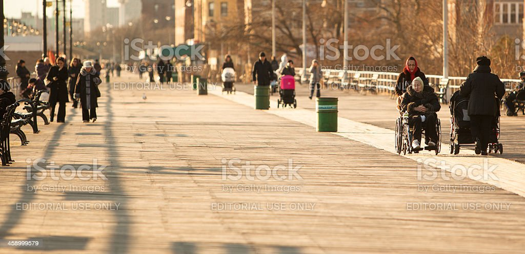 old disability women in wheelchair at Brighton Beach royalty-free stock photo