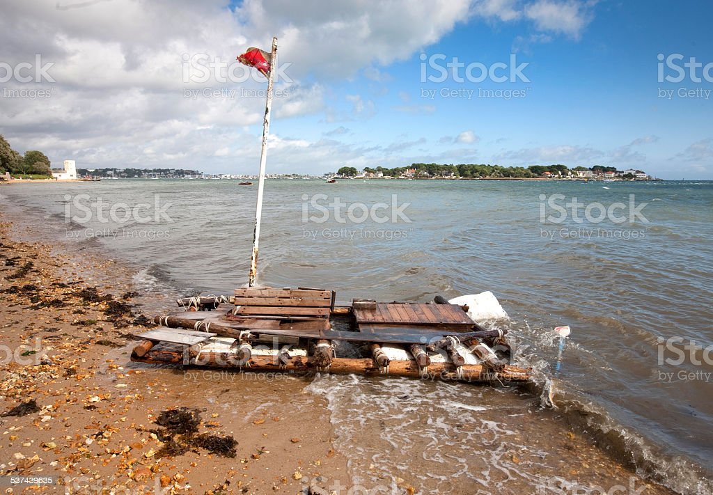 Old discarded raft on a beach stock photo