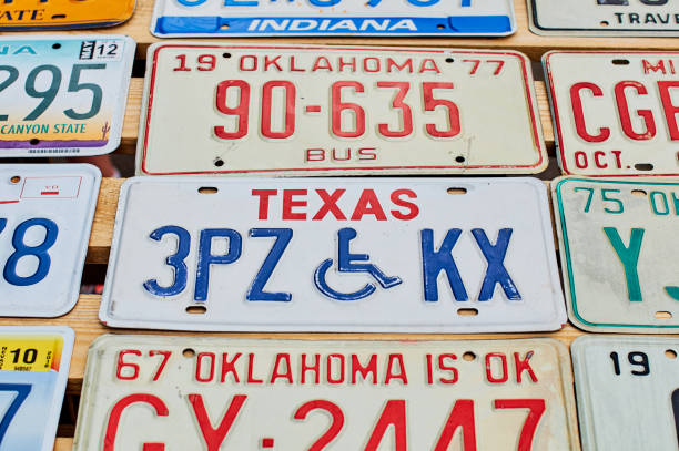Old discontinued car license plates or vehicle registration numbers from different USA states such as Texas, Oklahoma, Indiana. stock photo