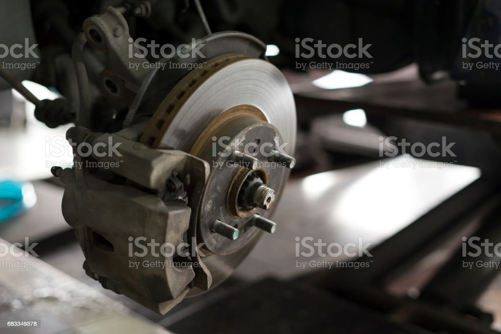 old disk break and wheel hub bearing ABS brakes stock photo