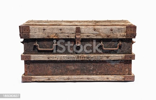 Old distressed metal trunk isolated on white background with accurate clipping path.