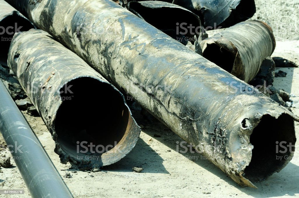 Old district heating pipes removed from the ground stock photo