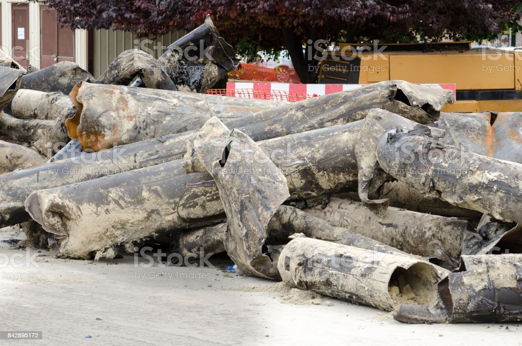 Old district heating pipes removed from the ground to be replaced with new pipeline stock photo