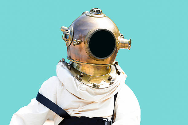 Old diving suit isolated with clipping path and copy space Old diving suit isolated on blue background, full frame horizontal with copy space, clipping path included wetsuit stock pictures, royalty-free photos & images