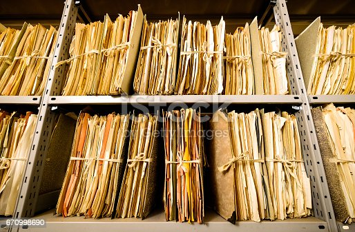 istock old documents at a rack - nice background 670998690