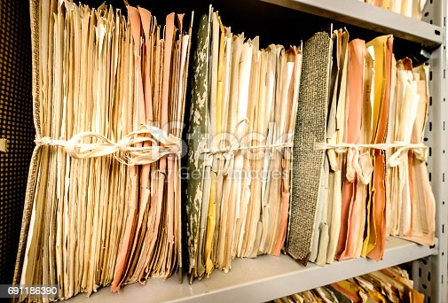 istock old documents at a rack - nice background 691186390
